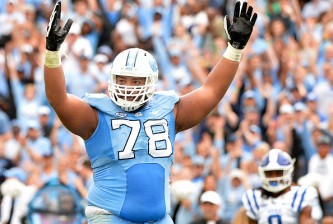 CHAPEL HILL, NC - NOVEMBER 07:  Landon Turner #78 of the North Carolina Tar Heels signals for a touchdown during their game against the Duke Blue Devils at Kenan Stadium on November 7, 2015 in Chapel Hill, North Carolina.  (Photo by Grant Halverson/Getty Images)