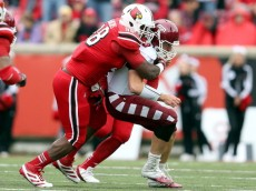 LOUISVILLE, KY - NOVEMBER 03:  Sheldon Rankins #98 of the Louisville Cardinals tackles Chris Coyer #10 of the Temple Owls at Papa John's Cardinal Stadium on November 3, 2012 in Louisville, Kentucky.  (Photo by Andy Lyons/Getty Images)