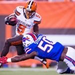 CLEVELAND, OH - AUGUST 20: Wide receiver Shane Wynn #5 of the Cleveland Browns is tackled by linebacker Tony Steward #50 of the Buffalo Bills during the second half of a preseason game at FirstEnergy Stadium on August 20, 2015 in Cleveland, Ohio. The Bills defeated the Browns 11-10. (Photo by Jason Miller/Getty Images)