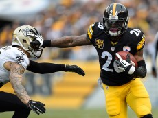 PITTSBURGH, PA - NOVEMBER 30:  Le'Veon Bell #26 of the Pittsburgh Steelers stiff arms Kenny Vaccaro #32 of the New Orleans Saints during the first quarter at Heinz Field on November 30, 2014 in Pittsburgh, Pennsylvania.  (Photo by Joe Sargent/Getty Images)