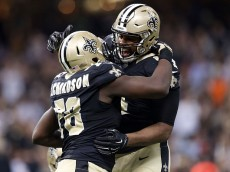 NEW ORLEANS, LA - DECEMBER 27:  Cameron Jordan #94 celebrates with Bobby Richardson #78 of the New Orleans Saints following an interception against the Jacksonville Jaguars at the Mercedes-Benz Superdome on December 27, 2015 in New Orleans, Louisiana.  (Photo by Sean Gardner/Getty Images)