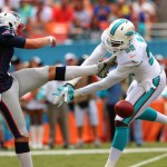 MIAMI GARDENS, FL - SEPTEMBER 07:  Ryan Allen #6, left, of the New England Patriots has his first quarter punt blocked by Chris McCain #58 of the Miami Dolphins during a game at Sun Life Stadium on September 7, 2014 in Miami Gardens, Florida.  (Photo by Mike Ehrmann/Getty Images)