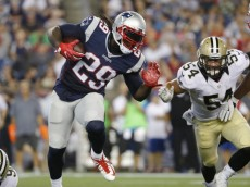 New England Patriots running back LeGarrette Blount (29) runs against New Orleans Saints linebacker Nate Stupar (54) during the first half of a preseason NFL football game Thursday, Aug. 11, 2016, in Foxborough, Mass. (AP Photo/Winslow Townson)