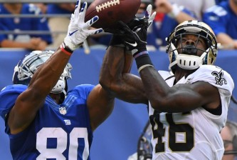 Sep 18, 2016; East Rutherford, NJ, USA;  New York Giants wide receiver Victor Cruz (80) and New Orleans Saints cornerback Ken Crawley (46) go for a fourth quarter pass at MetLife Stadium. Mandatory Credit: Robert Deutsch-USA TODAY Sports
