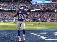 EAST RUTHERFORD, NJ - OCTOBER 21:  Victor Cruz #80 of the New York Giants celebrates after he scored the game winning touchdown in the fourth quarter against the Washington Redskins on October 21, 2012 at MetLife Stadium in East Rutherford, New Jersey.The New York Giants defeated the Washington Redskins 27-23.  (Photo by Elsa/Getty Images)
