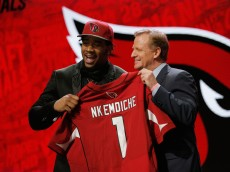 CHICAGO, IL - APRIL 28:  (L-R) Robert Nkemdiche of Ole Miss holds up a jersey with NFL Commissioner Roger Goodell after being picked #29 overall by the Arizona Cardinalsduring the first round of the 2016 NFL Draft at the Auditorium Theatre of Roosevelt University on April 28, 2016 in Chicago, Illinois.  (Photo by Jon Durr/Getty Images)