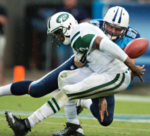 Here we see Geno Smith attempt to make a play out of a sack, which is almost always a poor decision. (Getty Images)