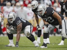 OAKLAND, CA - DECEMBER 7:  Guard Gabe Jackson #66 and tackle Donald Penn #72 of the Oakland Raiders prepare to block on a play against the San Francisco 49ers in the fourth quarter on December 7, 2014 at O.co Coliseum in Oakland, California.  The Raiders won 24-13.  (Photo by Brian Bahr/Getty Images)
