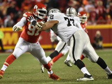 KANSAS CITY, MO - JANUARY 3: Tamba Hali #91 of the Kansas City Chiefs rushes the passer while being blocked by Donald Penn #72 of the Oakland Raiders at Arrowhead Stadium during the fourth quarter of the game on January 3, 2016 in Kansas City, Missouri. (Photo by Peter Aiken/Getty Images)