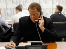 Green Bay Packers director of football operations Reggie McKenzie, left, and director of college scouting John Dorsey work the phones  the phones in the war room  at Lambeau Field for the NFL football draft, Thursday, April 22, 2010, in Green Bay, Wis. (AP Photo/Evan Siegle, Pool) ** POOL PHOTO **