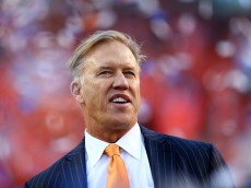 DENVER, CO - JANUARY 19:  John Elway, executive vice president of football operations for the Denver Broncos, celebrate after they defeated the New England Patriots 26 to 16 in the AFC Championship game at Sports Authority Field at Mile High on January 19, 2014 in Denver, Colorado.  (Photo by Elsa/Getty Images)