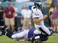 Aug 22, 2015; Philadelphia, PA, USA; Baltimore Ravens outside linebacker Terrell Suggs (55) tackles Philadelphia Eagles quarterback Sam Bradford (7) late and is called for a penalty during the first quarter at Lincoln Financial Field. Mandatory Credit: Bill Streicher-USA TODAY Sports