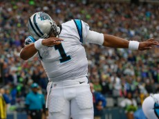 SEATTLE, WA - OCTOBER 18:  Quarterback Cam Newton #1 of the Carolina Panthers celebrates after scoring a touchdown against the Seattle Seahawks at CenturyLink Field on October 18, 2015 in Seattle, Washington.  (Photo by Otto Greule Jr/Getty Images)