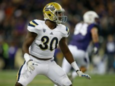 SEATTLE, WA - NOVEMBER 08:  Linebacker Myles Jack #30 of the UCLA Bruins defends against the Washington Huskies on November 8, 2014 at Husky Stadium in Seattle, Washington.  (Photo by Otto Greule Jr/Getty Images)