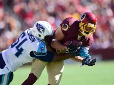 LANDOVER, MD - OCTOBER 19: Jordan Reed #86 of the Washington Redskins is tackled by Avery Williamson #54 of the Tennessee Titans at FedEx Field on October 19, 2014 in Landover, Maryland.  (Photo by Patrick McDermott/Getty Images)