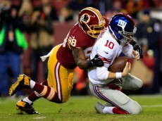 LANDOVER, MD - DECEMBER 01:  Brian Orakpo #98 of the Washington Redskins sacks Eli Manning #10 of the New York Giants in the first quarter during their game at FedExField on December 1, 2013 in Landover, Maryland.  (Photo by Rob Carr/Getty Images)