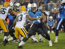 NASHVILLE, TN - AUGUST 09:  Tackle Taylor Lewan #77 of the Tennessee Titans plays against Ryan White #43 of the Green Bay Packers at LP Field on August 9, 2014 in Nashville, Tennessee.  (Photo by Frederick Breedon/Getty Images)