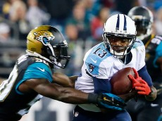 JACKSONVILLE, FL - DECEMBER 18:  Kendall Wright #13 of the Tennessee Titans tries to break the tackle of  Telvin Smith #50 of the Jacksonville Jaguars in the second quarter at EverBank Field on December 18, 2014 in Jacksonville, Florida.  (Photo by Sam Greenwood/Getty Images)