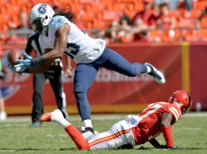 KANSAS CITY, MO - SEPTEMBER 07:  Michael Griffin #33 of the Tennessee Titans intercepts the ball intended for Donnie Avery #17 of the Kansas City Chiefs during the fourth quarter at Arrowhead Stadium on September 7, 2014 in Kansas City, Missouri.  (Photo by Peter Aiken/Getty Images)