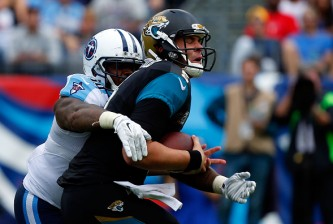 NASHVILLE, TN - OCTOBER 12:  Blake Bortles #5 of the Jacksonville Jaguars is sacked by Jurrell Casey #99 of the Tennessee Titans during the second quarter of a game at LP Field on October 12, 2014 in Nashville, Tennessee.  (Photo by Wesley Hitt/Getty Images)