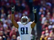 LANDOVER, MD - OCTOBER 19:  Derrick Morgan #91 of the Tennessee Titans reacts to a first-quarter play against the Washington Redskins at FedEx Field on October 19, 2014 in Landover, Maryland.  (Photo by Patrick McDermott/Getty Images)
