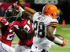 ATLANTA, GA - NOVEMBER 23: Robert McClain #27 of the Atlanta Falcons is stiff armed by Terrance West #28 of the Cleveland Browns in the first half at Georgia Dome on November 23, 2014 in Atlanta, Georgia.  (Photo by Scott Cunningham/Getty Images)