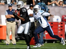 OAKLAND, CA - AUGUST 27:  Wide receiver Michael Crabtree #15 of the Oakland Raiders catches a 41 yard pass over defensive back Antwon Blake #47 of the Tennessee Titans in the first half of their preseason football game at the Oakland Coliseum on August 27, 2016 in Oakland, California.  (Photo by Thearon W. Henderson/Getty Images)