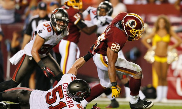 Running back Roy Helu #29 of the Washington Redskins drags Jacob Cutrera #51 of the Tampa Bay Buccaneers as he scores during the second half at FedExField on August 29, 2012 in Landover, Maryland. (August 28, 2012 - Source: Rob Carr/Getty Images North America)