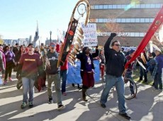 Protest against the Washington Redskins where bystanders look on in shock