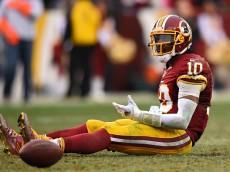 LANDOVER, MD - DECEMBER 28: Quarterback Robert Griffin III #10 of the Washington Redskins reacts after throwing a fourth quarter interception against the Dallas Cowboys at FedExField on December 28, 2014 in Landover, Maryland. The Dallas Cowboys won, 44-17. (Photo by Patrick Smith/Getty Images)