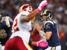 ST. LOUIS, MO - OCTOBER 2:  Sam Bradford #8 of the St. Louis Rams looks to pass against the Washington Redskins at the Edward Jones Dome on October 2, 2011 in St. Louis, Missouri.  (Photo by Dilip Vishwanat/Getty Images)