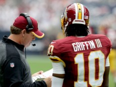 HOUSTON, TX- SEPTEMBER 07: Washington Redskins head coach Jay Gruden talks with Washington Redskins quarterback Robert Griffin III #10 on the sidelines against the Houston Texans in the second quarter on September 7, 2014 at NRG Stadium in Houston, Texas. (Photo by Thomas B. Shea/Getty Images)