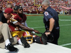 LANDOVER, MD - SEPTEMBER 14:  Quarterback Robert Griffin III #10 of the Washington Redskins is carted off the field after being injured during a game against the Jacksonville Jaguars at FedExField on September 14, 2014 in Landover, Maryland.  (Photo by Patrick Smith/Getty Images)
