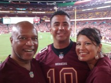 Anthony Brown, Skins Hog Heaven, with Robert (center) and Angeleque (right) Doore at the Redskins-Lions preseason game.