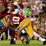 LANDOVER, MD - AUGUST 18: Quarterback Robert Griffin III #10 of the Washington Redskins is sacked during a preseason game against the Cleveland Browns at FedExField on August 18, 2014 in Landover, Maryland.  (Photo by Rob Carr/Getty Images)