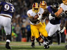 BALTIMORE, MD - AUGUST 23: Runningback Silas Redd #24 of the Washington Redskins looks for a hole during a preseason game against the Baltimore Ravens at M&T Bank Stadium on August 23, 2014 in Baltimore, Maryland.  (Photo by Larry French/Getty Images)