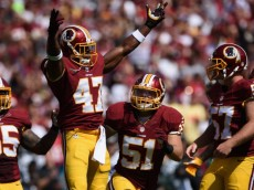 LANDOVER, MD - SEPTEMBER 14: Free safety Akeem Davis #47 of the Washington Redskins reacts after a second quarter tackle during a game against the Jacksonville Jaguars at FedExField on September 14, 2014 in Landover, Maryland.  (Photo by Patrick Smith/Getty Images)
