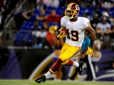 BALTIMORE, MD - AUGUST 23: Wide receiver Rashad Ross #19 of the Washington Redskins brings the ball up field during a preseason game against the Baltimore Ravens at M&T Bank Stadium on August 23, 2014 in Baltimore, Maryland.  (Photo by Larry French/Getty Images)