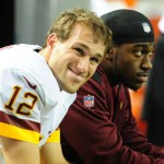 ATLANTA, GA - DECEMBER 15: Kirk Cousins #12 of the Washington Redskins chats with Robert Griffin III after throwing a 4th quarter interception against the Atlanta Falcons at the Georgia Dome on December 15, 2013 in Atlanta, Georgia. (Photo by Scott Cunningham/Getty Images)