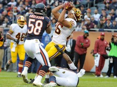 CHICAGO, IL- DECEMBER 13: Jordan Reed #86 of the Washington Redskins catches a pass near the goal line as he's defended by Jonathan Anderson #58 of the Chicago Bears during the first quarter on December 13, 2015 at Soldier Field in Chicago, Illinois.  (Photo by David Banks/Getty Images)