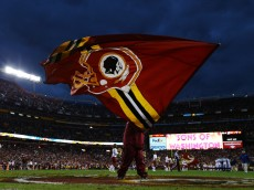 LANDOVER, MD - JANUARY 06:  A Washington Redskins flag is waved prior to the NFC Wild Card Playoff Game against the Seattle Seahawks at FedExField on January 6, 2013 in Landover, Maryland.  (Photo by Al Bello/Getty Images)