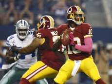 ARLINGTON, TX - OCTOBER 13:  Robert Griffin III #10 of the Washington Redskins throws a pass in the first quarter of a game against the Dallas Cowboys at AT&T Stadium on October 13, 2013 in Arlington, Texas.  (Photo by Tom Pennington/Getty Images)