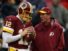 LANDOVER, MD - DECEMBER 22:  Quarterback Kirk Cousins #12 of the Washington Redskins talks with head coach Mike Shanahan during warmups prior to playing an NFL game against the Dallas Cowboys at FedExField on December 22, 2013 in Landover, Maryland.  (Photo by Patrick McDermott/Getty Images)