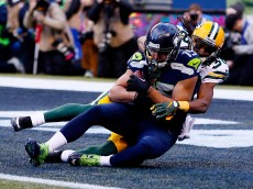 SEATTLE, WA - JANUARY 18:  Jermaine Kearse #15 of the Seattle Seahawks catches a 35 yard game-winning touchdown in overtime against the Green Bay Packers during the 2015 NFC Championship game at CenturyLink Field on January 18, 2015 in Seattle, Washington.  (Photo by Kevin C. Cox/Getty Images)