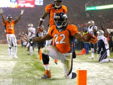 DENVER, CO - NOVEMBER 29: Running back C.J. Anderson #22 of the Denver Broncos celebrates after scoring a fourth quarter touchdown against the New England Patriots at Sports Authority Field at Mile High on November 29, 2015 in Denver, Colorado. (Photo by Justin Edmonds/Getty Images)