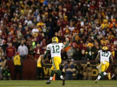 LANDOVER, MD - JANUARY 10: Quarterback Aaron Rodgers #12 of the Green Bay Packers celebrates a first down against the Washington Redskins in the third quarter during the NFC Wild Card Playoff game at FedExField on January 10, 2016 in Landover, Maryland. (Photo by Patrick Smith/Getty Images)