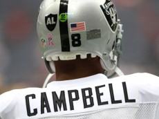 HOUSTON, TX - OCTOBER 09:  Quarterback Jason Campbell #8 of  the Oakland Raiders who is wearing a Black AL in the form of a Raider shield on the back of helmet warms up before playing against the Houston Texans on October 9, 2011 at Reliant Stadium in Houston, Texas. Raider owner, Al Davis died at age 82 at his home Saturday morning.  (Photo by Thomas B. Shea/Getty Images)