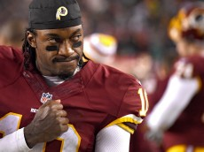 LANDOVER, MD - DECEMBER 20: Quarterback Robert Griffin III #10 of the Washington Redskins acknowledges the crowd as time expires in the fourth quarter against the Philadelphia Eagles at FedExField on December 20, 2014 in Landover, Maryland. The Washington Redskins won, 27-24. (Photo by Patrick Smith/Getty Images)