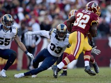 LANDOVER, MD - DECEMBER 07: Running back Silas Redd #32 of the Washington Redskins breaks through the tackle of cornerback E.J. Gaines #33 of the St. Louis Rams at FedExField on December 7, 2014 in Landover, Maryland.  (Photo by Patrick Smith/Getty Images)