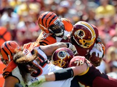 LANDOVER, MD - SEPTEMBER 23:    Robert Griffin III #10 of the Washington Redskins is sacked by Michael Johnson #93 of the Cincinnati Bengals during the first half at FedExField on September 23, 2012 in Landover, Maryland.  (Photo by Patrick McDermott/Getty Images)